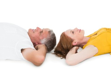Casual couple lying on floor