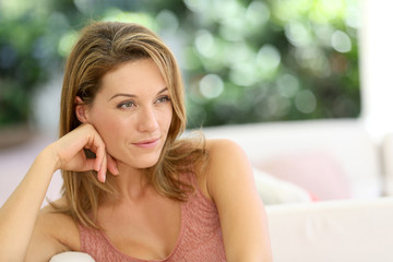 Portrait of attractive blond woman at home