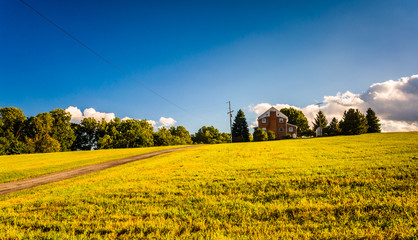 Evening light on a house in a field, York County, Pennsylvania.