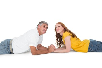 Casual couple lying and looking up