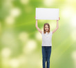smiling little girl holding blank white board