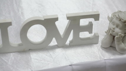 wooden sign LOVE on wedding table