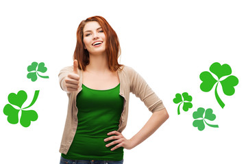 smiling teen girl with shamrock showing thumbs up