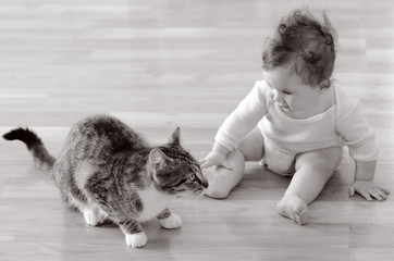Baby plays with animal