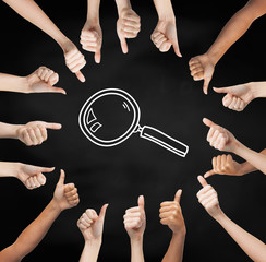 hands showing thumbs up in circle over magnifier
