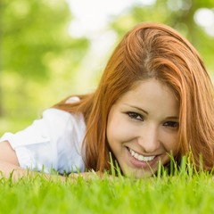 Portrait of a pretty redhead smiling and lying