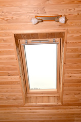 Window on a penthouse of the wooden house