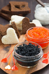 festive appetizer - toasts, red and black caviar, vertical