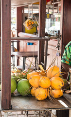 Yellow and Green Coconuts in a Market