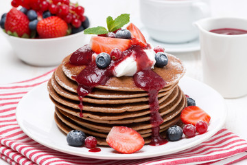 pancakes with cream, fruit sauce and berries