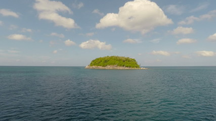 Island in the ocean from a height of 20 meters.