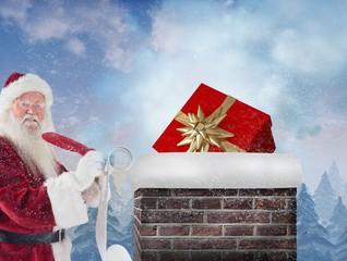 Composite image of santa writing his list