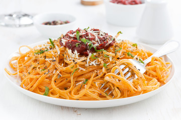 spaghetti with tomato sauce and parmesan, close-up