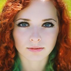 Beautiful redhead girl face closeup.