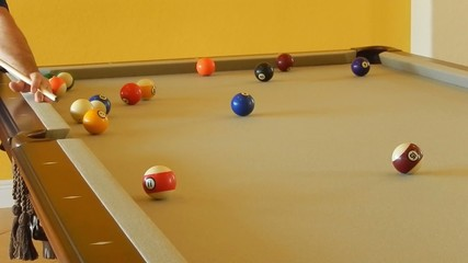 pool player at billiards table