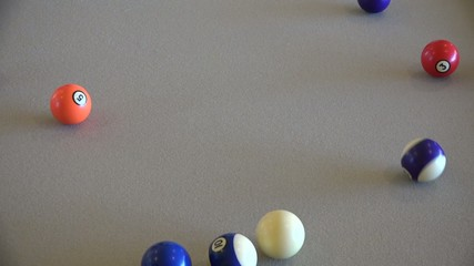 Professional pool player at billiards table