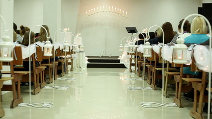 elements of the wedding decor with candles at a wedding ceremony