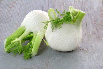 fennel isolated on wooden background