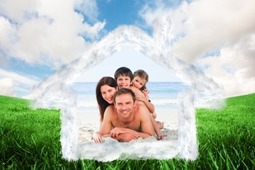 Composite image of family on the beach