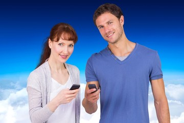 Composite image of couple using their mobile phones