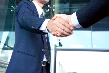 Handshake of businessmen - successful & partnership concepts