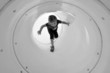 Child plays in playground tunnel