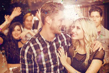 Composite image of stylish couple smiling and dancing together