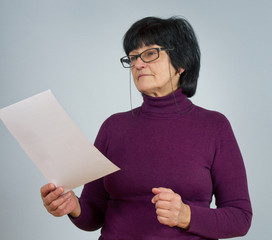 Adult woman with glasses.