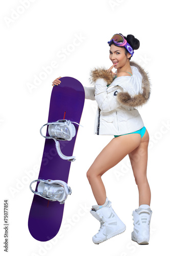 Leinwandbild Motiv Sexy dressed woman with snowboard