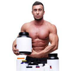 Portrait of a handsome muscular man with sports nutrtion