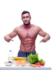 Portrait of a handsome muscular man with healthy food