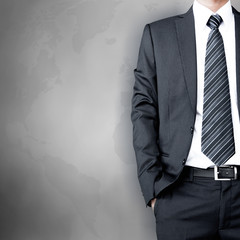 A man in business attire on world map background