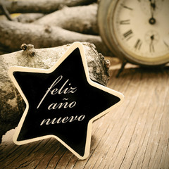 feliz ano nuevo, happy new year in spanish, in a star-shaped cha