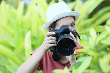 Woman photographer taking picture of nature