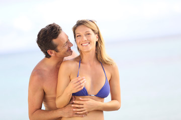Cheerful 40-year-old couple at the beach