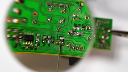 Soldering a Circuit Board under the Magnifying Glass