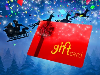 Composite image of santa flying his sleigh behind gift card