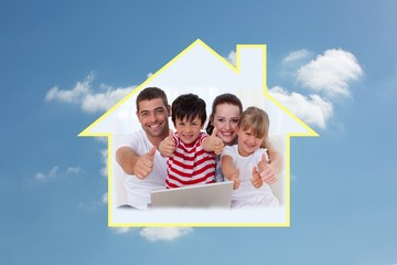 Composite image of family at home using a laptop with thumbs up