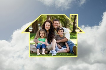 Composite image of happy family sitting in the garden
