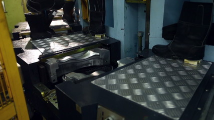 View of unfinished boots on production machine