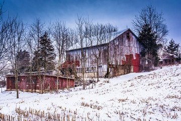 Old barn and a snow covered field in rural York County, Pennsylv