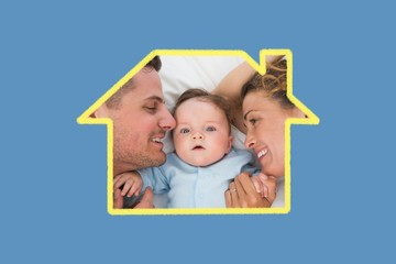 Composite image of cute baby with parents in bed