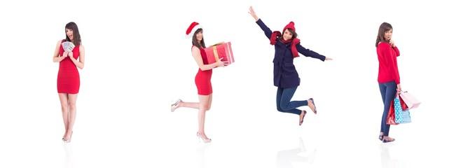 Composite image of festive brunette holding gift bags