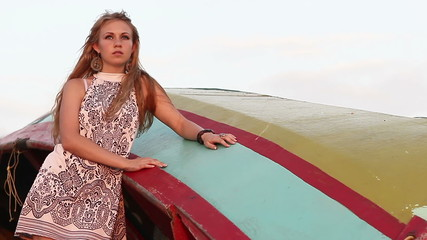 girl in black and white dress near a boat and look