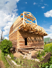 Construction of a new wooden house in summertime