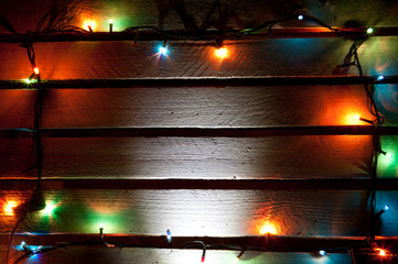 christmas colorful  light on wooden background with copy space