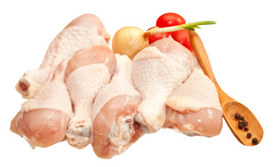 Raw chicken legs with vegetables, isolated on white background