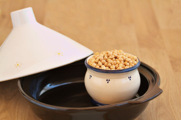 Bowl filled with chick peas inside a tagine
