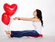 Happy girl with balloons heart in studio