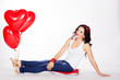 Valentine's day. Sexy brunette with red balloons